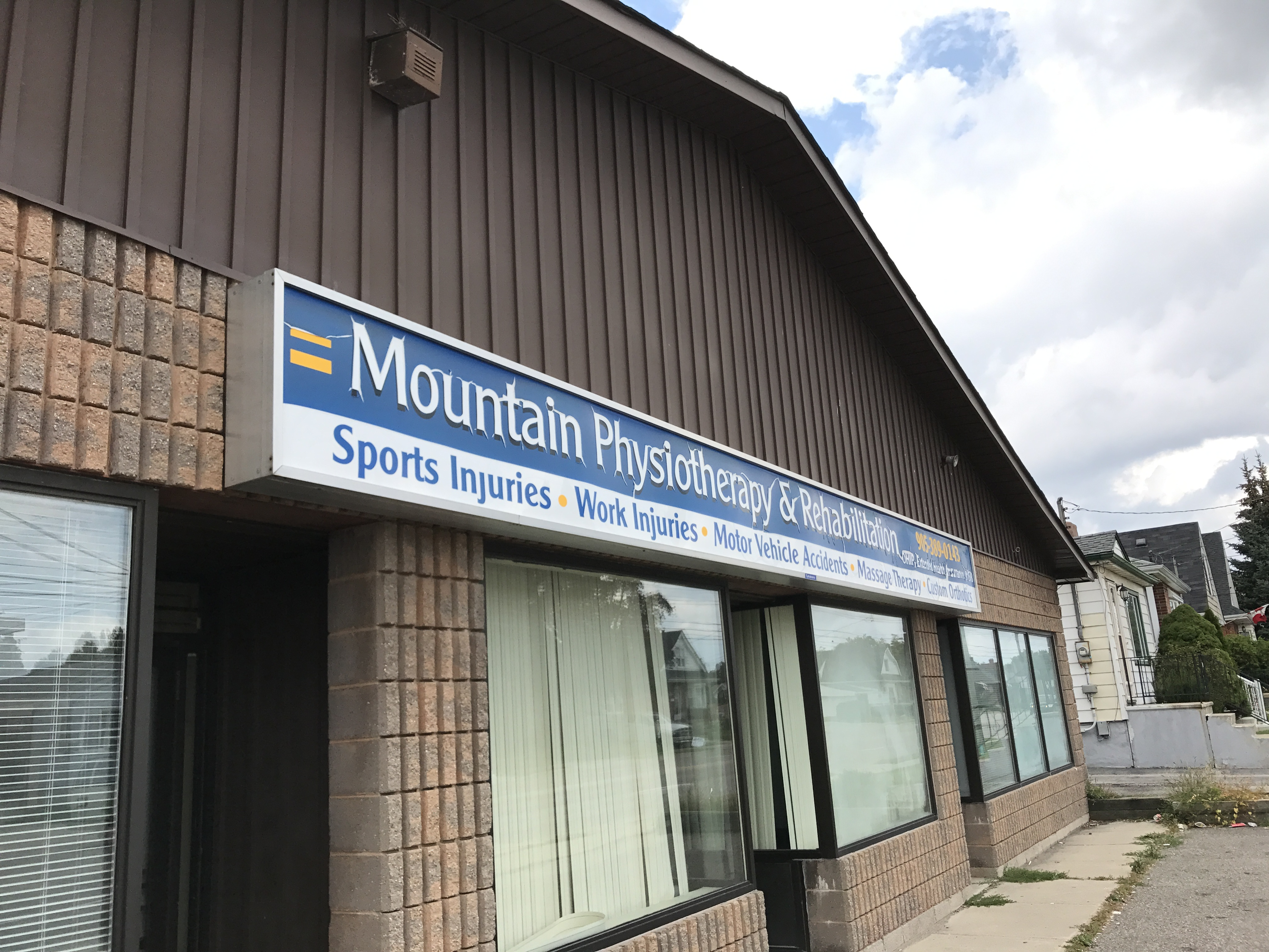 Building exterior and front sign for Mountain physiotherapy