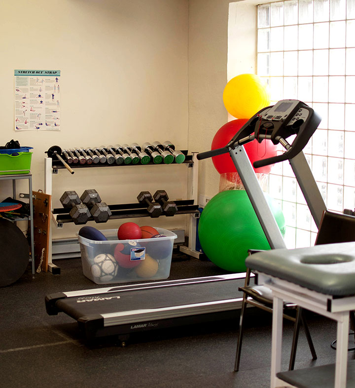 Photograph of the gym area of Victoria physiotherapy showing exercise balls and a treadmill.