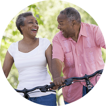 Older couple laughing and enjoying a bike ride