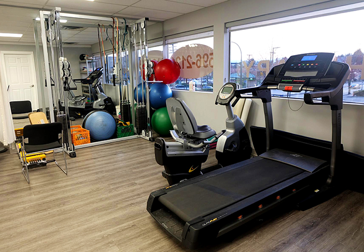 Newton Physiotherapy treatment area with treadmill