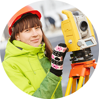 Woman in hard hat with surveying equipment