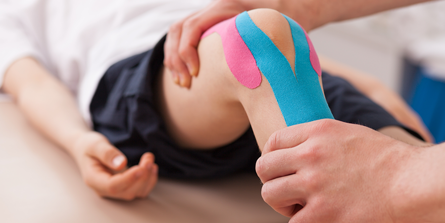 Woman receiving kinesio tape