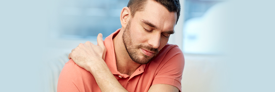 Man experiencing shoulder pain