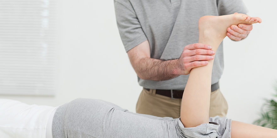 Woman getting treatment for achilles tendon injury.