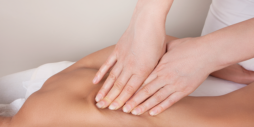 photograph of woman performing deep tissue massage therapy