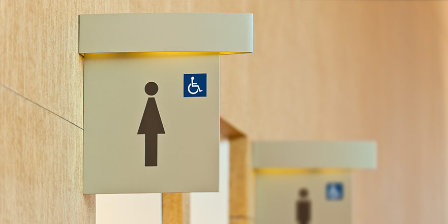 Urinary Incontinence in Women, Sign of women's public bathroom