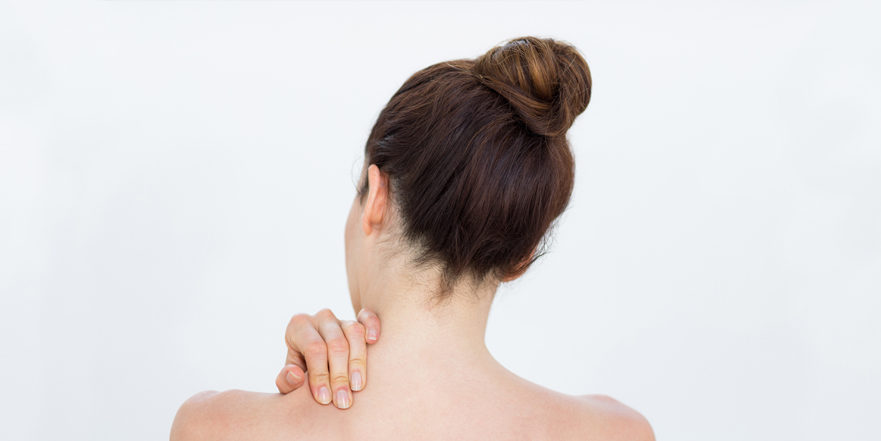 Woman holds clicking, popping shoulder.