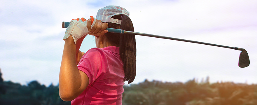 Woman golfing after receiving dry needling therapy