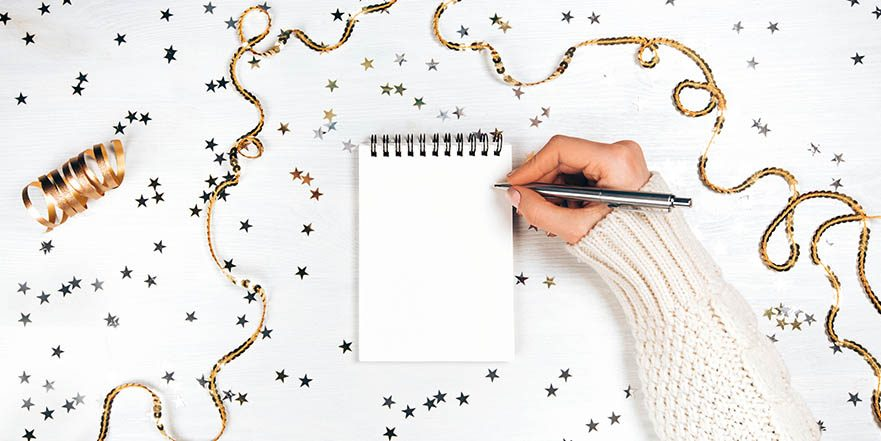 #GOALS Image of a woman setting a SMART goal for her new years resolution.