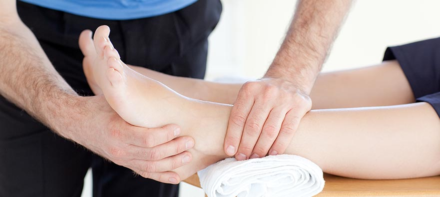 Photo of a physiotherapist assessing a patient's top of foot pain