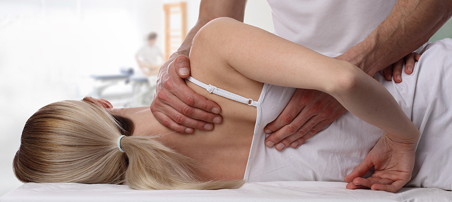 Photograph of a woman receiving manual therapy for migraine relief