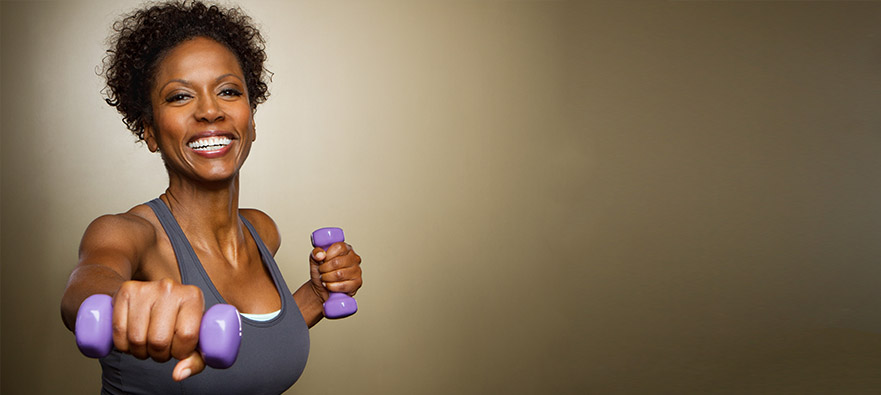Photograph of a woman wearing exercise clothing and holding weights
