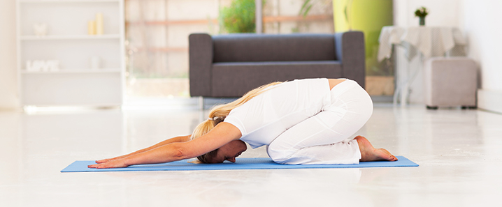 Image of a woman doing yoga as a part of her preventative care for osteoarthritis