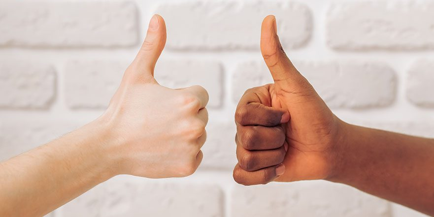 Photograph of two hands giving a thumbs up after getting physiotherapy treatment for trigger thumb
