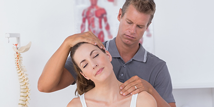 photograph of a chiropractor performing traction on a female patient