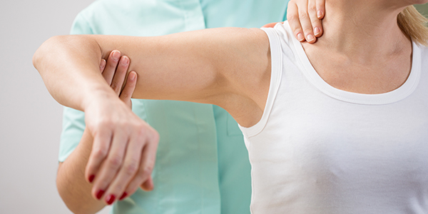Photo of woman receiving physiotherapy for frozen shoulder