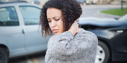 photograph of a woman with whiplash following a car accident