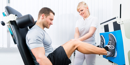photograph of a man receiving athletic therapy