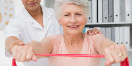 photograph of a an older woman getting OHIP funded physiotherapy