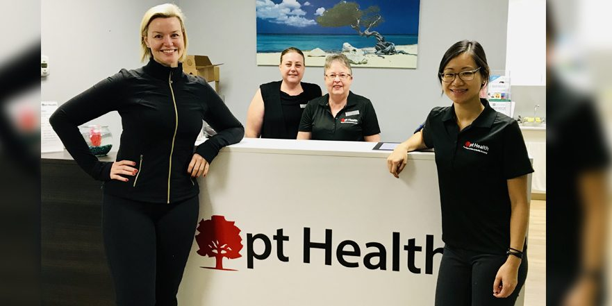 photograph of the harvester physiotherapy pt health team standing at the front reception desk.