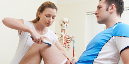 photograph of a physiotherapist using phonophoresis to deliver medication
