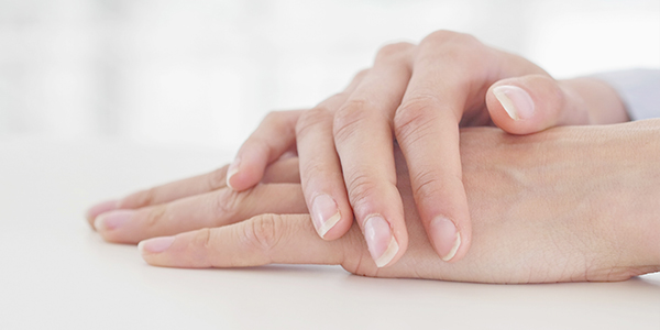 Photograph of a hands resting because of trigger finger