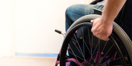 photograph of a person in a wheelchair following a spinal cord injury