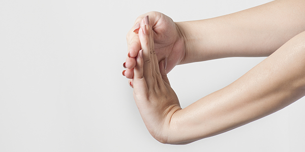 photograph of hands stretching to improve trigger finger