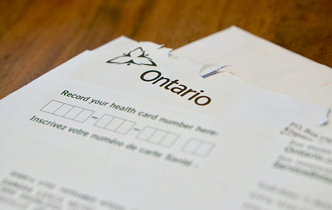 "Paperwork for Ontario Health Care, focusing on ""Record your health card number"" section"