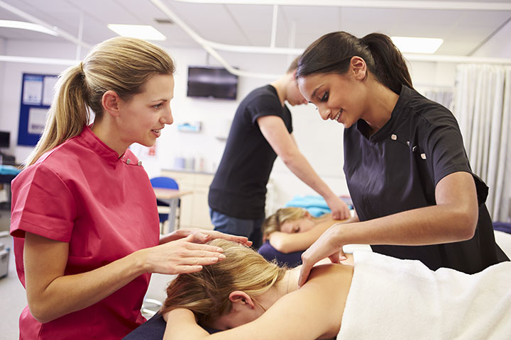 students performing massage