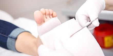photograph of a podiatrist bandaging a foot