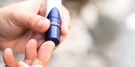 photograph of a diabetes patient checking their blood sugar