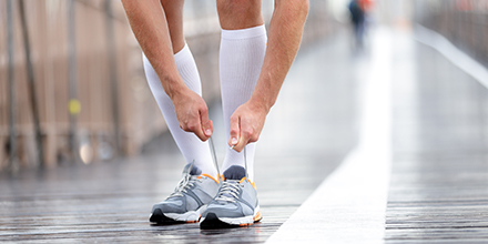 photograph of a runner wearing compression socks to improve circulation