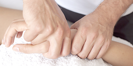 photograph of a certified hand therapist performing pain relieving hand exercises and splinting