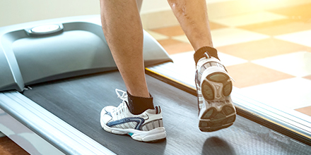 photograph of an injured athlete running on a threadmill
